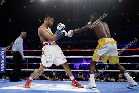England's Amir Khan, left, fights Terence Crawford during the third round of a WBO world welterweight championship boxing match, in New York. Crawford won the fight