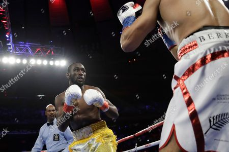 Terence Crawford, left, during the first round of a WBO world welterweight championship boxing match against England's Amir Khan, in New York. Crawford won the fight