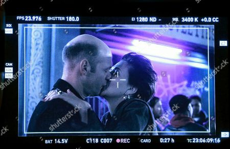 Maggie Gyllenhaal and Corey Stoll kiss during a scene