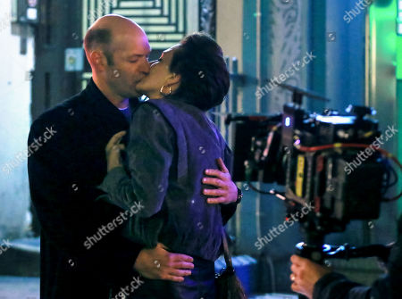 Stock Image of Maggie Gyllenhaal and Corey Stoll kiss during a scene