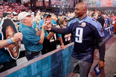 Former Tennessee Titans player Eddie George meets fans after announcing the pick for the Titans as Mississippi wide reciever A.J. Brown during the second round of the NFL football draft, in Nashville, Tenn