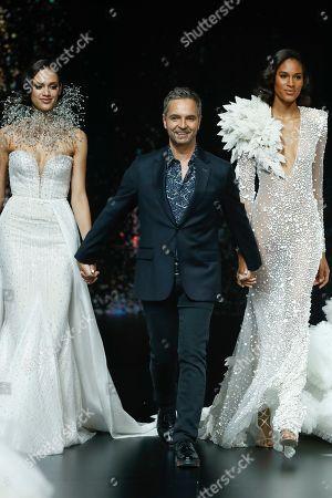 Dalianah Arekion, Herve Moreau and Cindy Bruna on the catwalk