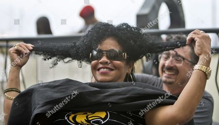 A woman gets a haircut during a free session for people with afros and curly hair, with the participation of guest hairdressers from the US, Australia and Puerto Rico, in Havana, Cuba, 26 April 2019.