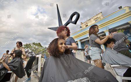 Stock Image of A group of people get haircuts during a free session for people with afros and curly hair, with the participation of guest hairdressers from the US, Australia and Puerto Rico, in Havana, Cuba, 26 April 2019.