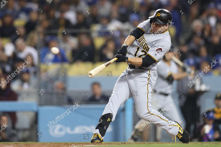 Pittsburgh Pirates left fielder JB Shuck (17) gets a pitch hit single during the game between the Pittsburg Pirates and the Los Angeles Dodgers at Dodger Stadium in Los Angeles, CA. (Photo by Peter Joneleit)