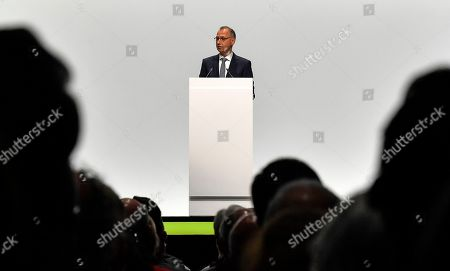 Stock Image of CEO Werner Baumann speaks during the annual general meeting of Bayer AG in Bonn, Germany. Following the record acquisition of U.S. biotech and seed company Monsanto, Bayer lost around half of its value in market capitalization. For the first time shareholders did not approve the actions of the Management Board