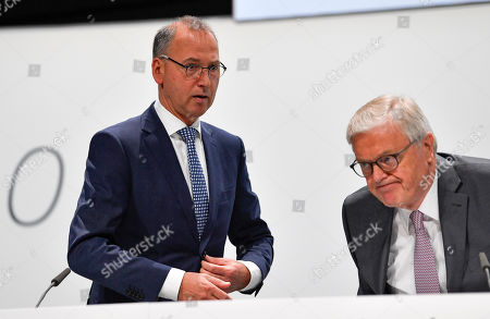 Stock Photo of CEO Werner Baumann, left, stands beside the Chairman of the Supervisory Board Werner Wenning, right, during the annual general meeting of Bayer AG in Bonn, Germany. Following the record acquisition of U.S. biotech and seed company Monsanto, Bayer lost around half of its value in market capitalization. For the first time shareholders did not approve the actions of the Management Board