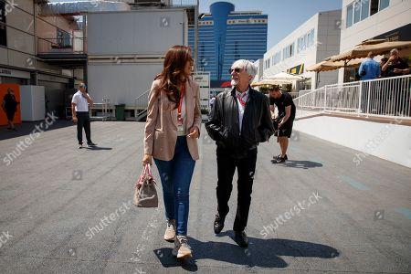 Stock Image of Former Formula One chairman Bernie Ecclestone (R) with his wife Fabiana Flosi (L) walk through the paddock at the Baku City Circuit in Baku, Azerbaijan, 27 April 2019. The 2019 Formula One Grand Prix of Azerbaijan will take place on 28 April.