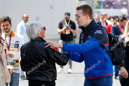 Former Formula One chairman Bernie Ecclestone (L) talks to Russian Formula One driver Daniil Kvyat of Scuderia Toro Rosso (R) at the Baku City Circuit in Baku, Azerbaijan, 27 April 2019. The 2019 Formula One Grand Prix of Azerbaijan will take place on 28 April.