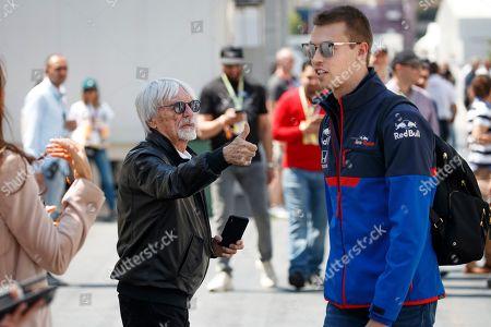 Former Formula One boss Bernie Ecclestone (L) talks to Russian Formula One driver Daniil Kvyat of Scuderia Toro Rosso (R) at the Baku City Circuit in Baku, Azerbaijan, 27 April 2019. The 2019 Formula One Grand Prix of Azerbaijan will take place on 28 April.