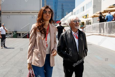 Former Formula One chairman Bernie Ecclestone (R) with his wife Fabiana Flosi (L) walk through the paddock at the Baku City Circuit in Baku, Azerbaijan, 27 April 2019. The 2019 Formula One Grand Prix of Azerbaijan will take place on 28 April.