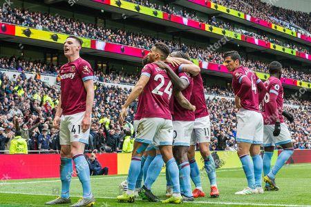 Declan Rice (West Ham) celebrates Michail Antonio (West Ham) goal in front of West Ham FC supporters during the Premier League match between Tottenham Hotspur and West Ham United at Tottenham Hotspur Stadium, London