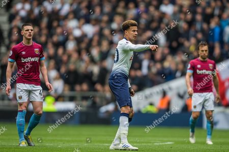 Dele Alli (Tottenham) pointing to the ball with Declan Rice (West Ham) & Mark Noble (Capt) (West Ham) in the background during the Premier League match between Tottenham Hotspur and West Ham United at Tottenham Hotspur Stadium, London