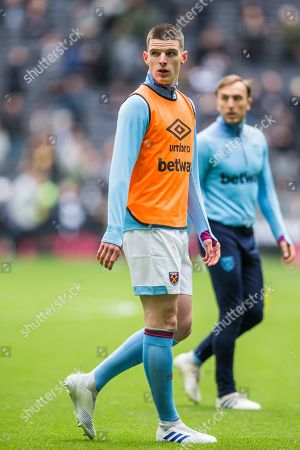 Stock Photo of Declan Rice (West Ham) warming up ahead of the Premier League match between Tottenham Hotspur and West Ham United at Tottenham Hotspur Stadium, London
