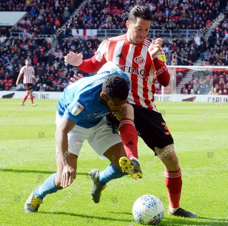 Nathan Thompson and Bryan Oviedo go for the ball during the EFL Sky Bet League 1 match between Sunderland and Portsmouth at the Stadium Of Light, Sunderland
