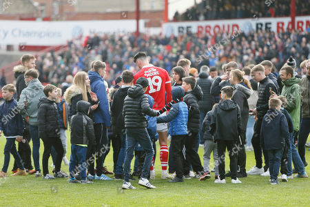 Barnsley fanssurround Barnsley forward Kieffer Moore (19) at full time during the EFL Sky Bet League 1 match between Barnsley and Blackpool at Oakwell, Barnsley