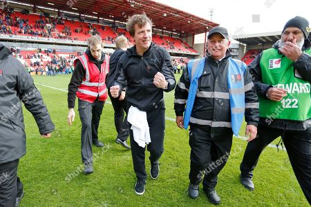 Barnsley Manager Daniel Stendel is mobbed by fans during a lap of honour at full time during the EFL Sky Bet League 1 match between Barnsley and Blackpool at Oakwell, Barnsley