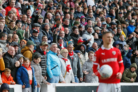 Barnsley fans celebrate during the EFL Sky Bet League 1 match between Barnsley and Blackpool at Oakwell, Barnsley