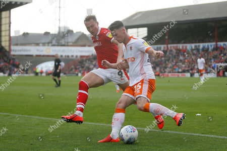 Barnsley forward Cauley Woodrow (9) and Blackpool midfielder Jordan Thompson (15)  during the EFL Sky Bet League 1 match between Barnsley and Blackpool at Oakwell, Barnsley