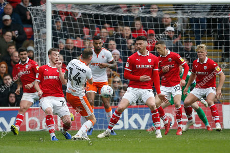 A shot by Blackpool midfielder Harry Pritchard (14)  during the EFL Sky Bet League 1 match between Barnsley and Blackpool at Oakwell, Barnsley