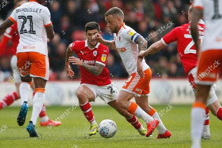 Stock Image of Blackpool midfielder Jay Spearing (8) and Barnsley midfielder Alex Mowatt (27)  during the EFL Sky Bet League 1 match between Barnsley and Blackpool at Oakwell, Barnsley
