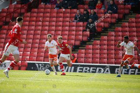 Barnsley forward Cauley Woodrow (9) goes past Blackpool midfielder Harry Pritchard (14)  during the EFL Sky Bet League 1 match between Barnsley and Blackpool at Oakwell, Barnsley