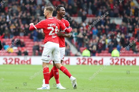 Middlesbrough midfielder Lewis Wing (26) celebrates with Middlesbrough midfielder John Obi Mikel (2) after scoring his team's first goal during the EFL Sky Bet Championship match between Middlesbrough and Reading at the Riverside Stadium, Middlesbrough