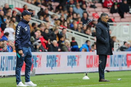 Middlesbrough Manager, Tony Pulis  and Reading Manager, Jose Gomes watch the play during the EFL Sky Bet Championship match between Middlesbrough and Reading at the Riverside Stadium, Middlesbrough