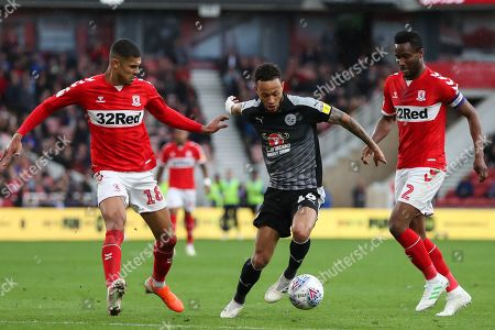 Reading midfielder Lewis Baker (16) on the ball under pressure from Middlesbrough forward Ashley Fletcher (18) and Middlesbrough midfielder John Obi Mikel (2) during the EFL Sky Bet Championship match between Middlesbrough and Reading at the Riverside Stadium, Middlesbrough