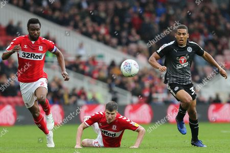 Reading midfielder Andy Rinomhota (35) and Middlesbrough midfielder John Obi Mikel (2) chase the ball with Middlesbrough midfielder Paddy McNair (17) looking on during the EFL Sky Bet Championship match between Middlesbrough and Reading at the Riverside Stadium, Middlesbrough