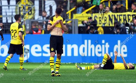 Dortmund players (L-R) Christian Pulisic, Julian Weigl, and Jadon Sancho react after the German Bundesliga soccer match between Borussia Dortmund and FC Schalke 04 in Dortmund, Germany, 27 April 2019.