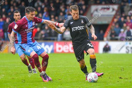 Billy Clarke of Bradford City (17) and Adam Hammill of Scunthorpe United (47) in action during the EFL Sky Bet League 1 match between Scunthorpe United and Bradford City at Glanford Park, Scunthorpe