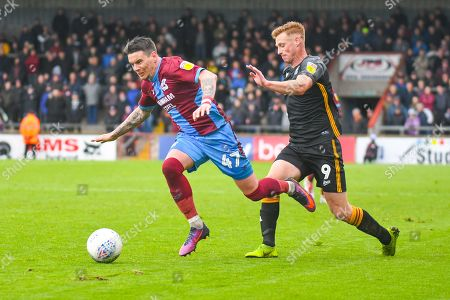 Adam Hammill of Scunthorpe United (47) escapes Eoin Doyle of Bradford City (9) during the EFL Sky Bet League 1 match between Scunthorpe United and Bradford City at Glanford Park, Scunthorpe