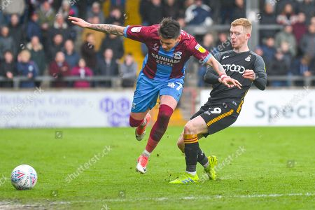 Adam Hammill of Scunthorpe United (47) and Lewis O'Brien of Bradford City (39) during the EFL Sky Bet League 1 match between Scunthorpe United and Bradford City at Glanford Park, Scunthorpe