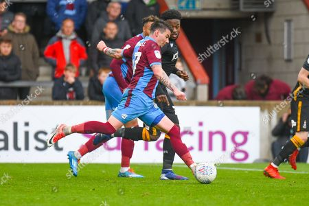 Adam Hammill of Scunthorpe United (47) shoots during the EFL Sky Bet League 1 match between Scunthorpe United and Bradford City at Glanford Park, Scunthorpe