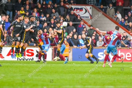 Adam Hammill of Scunthorpe United (47) shoots from a free kick during the EFL Sky Bet League 1 match between Scunthorpe United and Bradford City at Glanford Park, Scunthorpe
