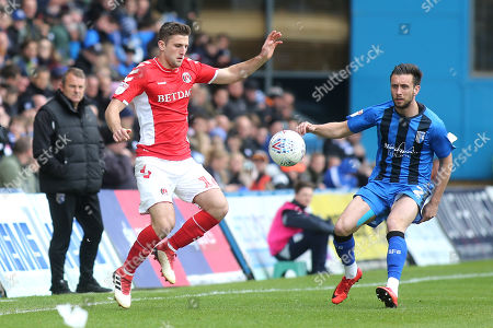 Ben Purrington of Charlton Athletic and Gillingham's Luke O'Neill during Gillingham vs Charlton Athletic, Sky Bet EFL League 1 Football at The Medway Priestfield Stadium on 27th April 2019