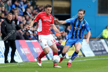 Ben Purrington of Charlton Athletic in possession as Gillingham's Luke O'Neill looks on during Gillingham vs Charlton Athletic, Sky Bet EFL League 1 Football at The Medway Priestfield Stadium on 27th April 2019