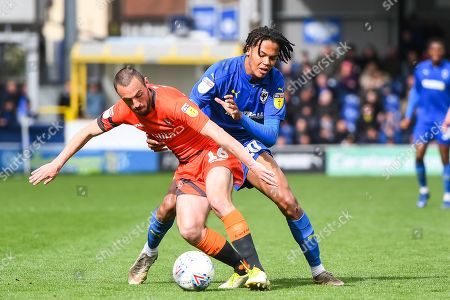 Wycombe Wanderers Defender Michael Harriman (16) and AFC Wimbledon Defender Toby Sibbick (20) in action during the EFL Sky Bet League 1 match between AFC Wimbledon and Wycombe Wanderers at the Cherry Red Records Stadium, Kingston