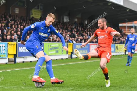 AFC Wimbledon Forward Joe Pigott (39) and Wycombe Wanderers Defender Michael Harriman (16) in action during the EFL Sky Bet League 1 match between AFC Wimbledon and Wycombe Wanderers at the Cherry Red Records Stadium, Kingston