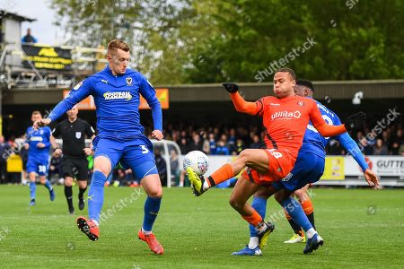 Wycombe Wanderers Midfielder Curtis Thompson (18) and AFC Wimbledon Forward Joe Pigott (39) in action during the EFL Sky Bet League 1 match between AFC Wimbledon and Wycombe Wanderers at the Cherry Red Records Stadium, Kingston