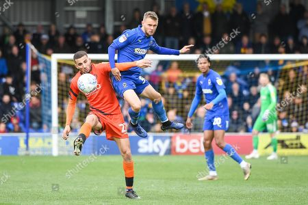 AFC Wimbledon Midfielder Shane McLoughlin (38) and Wycombe Wanderers Midfielder Nick Freeman (22) during the EFL Sky Bet League 1 match between AFC Wimbledon and Wycombe Wanderers at the Cherry Red Records Stadium, Kingston