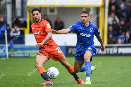 Wycombe Wanderers Forward Nathan Tyson (23) and AFC Wimbledon Defender Tennai Watson (2) in action during the EFL Sky Bet League 1 match between AFC Wimbledon and Wycombe Wanderers at the Cherry Red Records Stadium, Kingston
