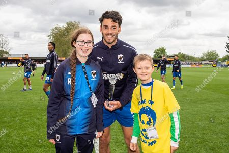 AFC Wimbledon Defender Will Nightingale (5) receives an award during the EFL Sky Bet League 1 match between AFC Wimbledon and Wycombe Wanderers at the Cherry Red Records Stadium, Kingston