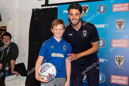 AFC Wimbledon Defender Will Nightingale (5) is award the Man of the Match award after the EFL Sky Bet League 1 match between AFC Wimbledon and Wycombe Wanderers at the Cherry Red Records Stadium, Kingston