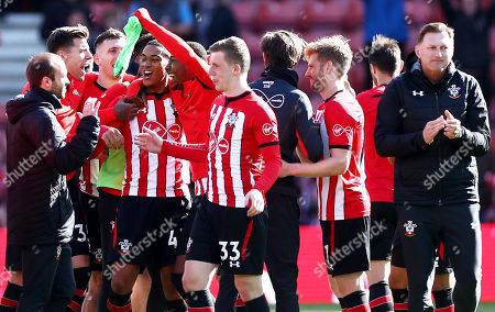 Southampton players celebrate at full time after hearing the scores from other games, sealing their Premier League survival.