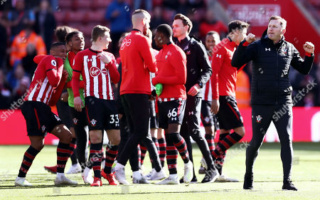 Southampton players and Southampton Manager Ralph Hasenhuttl celebrate at full time after hearing the scores from other games, sealing their Premier League survival.