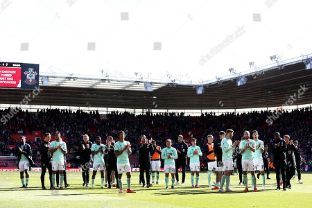 Bournemouth players applaud at full time.
