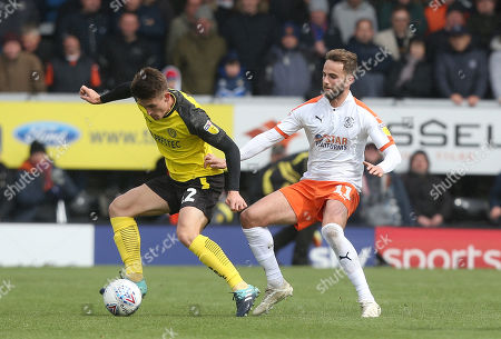 Stock Picture of Ben Fox of Burton Albion battles with Luton Town's Andrew Shinnie