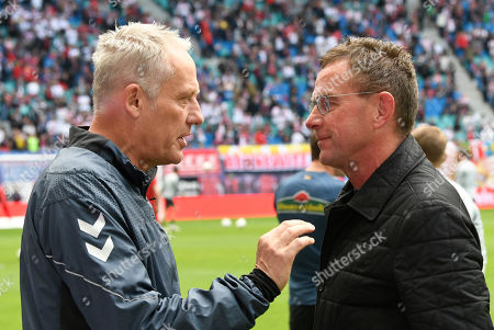 Leipzig's head coach Ralf Rangnick, right, welcomes Freiburg coach Christian Streich, left, prior to the German Bundesliga soccer match between RB Leipzig and SC Freiburg in Leipzig, Germany